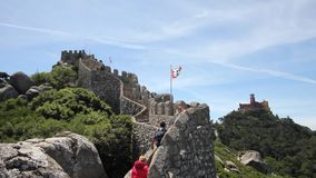 People walking on the walls of the Castle of the Moors, Sintra, Portugal stock video