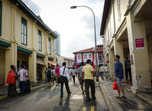 People walking at weekend market in Little India, Singapore Stock Photo