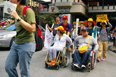 People walking in wheelchair against the construction of a dam in Mae Wong National Park Stock Images