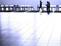 People walking on White Reflective Floor Royalty Free Stock Photography