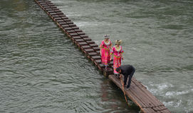 People walking on the wooden bridge at Fenghuang town in Hunan, China Stock Image