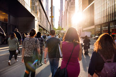 People walking from the work at the street in New York City at sunset time Royalty Free Stock Photos