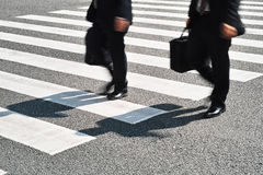 People walking on zebra crossing street Stock Images