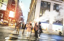People walking on zebra crossing on West 31th st in Manhattan - New York City stock photo