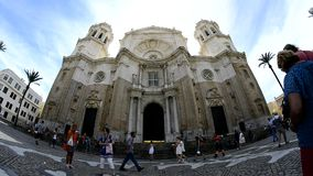 People walkingon the square in front of the Cathedral Facade, Cadiz stock video