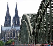 People Walling on Cologne Bridge Near Cologne Cathedral during Daytime Royalty Free Stock Image