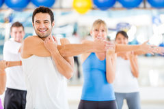 People warming up at the gym Stock Images