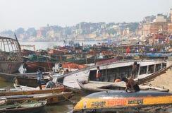 Ganges river ghat Varanasi India. People wash boats on Ganges river in Varanasi India Royalty Free Stock Image