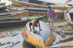Ganges river ghat Varanasi India. People wash boats on Ganges river in Varanasi India Royalty Free Stock Photo