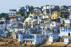 People wash themselves in the holy lake in the City of Pushkar, Stock Image