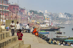 People wash themselves in the river Ganga in the holy city of Varanasi Royalty Free Stock Image
