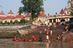 People wash in water near the Kali Temple Royalty Free Stock Photography