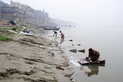 People washing clothes at ghats on the banks of Ganges river Stock Photography