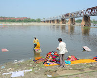 People washing clothes on the river Stock Photography