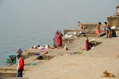 People washing clothes on sacred river Narmada ghats at Maheshwa Royalty Free Stock Image