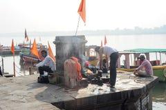 People washing clothes on sacred river Narmada ghats at Maheshwa Stock Photo