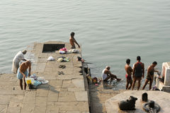 People washing clothes on sacred river Narmada ghats at Maheshwa Royalty Free Stock Photo