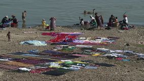 People washing clothes in the river, Mandalay, Myanmar. Women washing clothes in the river, Mandalay, Myanmar stock video