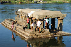 People washing clothes and themselves in the river at Hampi Stock Photo