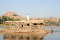 People washing clothes and themselves in the river at Hampi Royalty Free Stock Photo