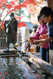 People washing the hand before entering to the temple at Mt.Takao Stock Images