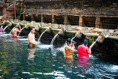 People washing at Pura Tirta Empul Temple, Bali, Indonesia Stock Photos
