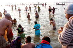 People washing in the river. Crowd of people washing in the confluence of the Ganges and the Yamuna during the Kumbh Mela in Allahabad India. In 2013, Kumbh Mela Stock Image