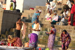 People washing their clothes in Ganges River, Varanasi, India Stock Photo