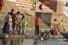 People washing their clothes in Ganges River, Varanasi, India Royalty Free Stock Image