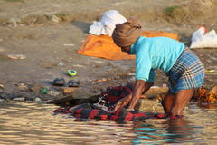 People washing their clothes in Ganges River, Varanasi, India Royalty Free Stock Photo
