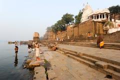 People washing themselves on sacred river Narmada at Maheshwar Stock Image
