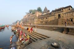 People washing themselves on sacred river Narmada at Maheshwar Stock Photo