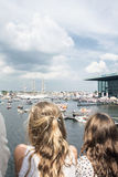 The people watch the boats in the sea in Europe royalty free stock photos