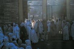 People watch the ceremony. AXUM, ETHIOPIA - APRIL 20: people watch the ceremony of the holy ark y through the streets on April 20,1998 in Axum, Ethiopia. The ark stock photos