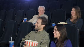 People watch comedy at the movie theater