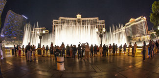 People watch famous Bellagio Hotel in Las Vegas. LAS VEGAS - JUNE 15: people watch the famous fountain show at Las Vegas Bellagio Hotel Casino at night on June stock photography