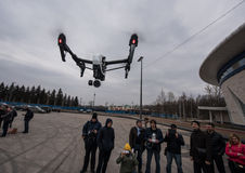 People watch the flight of Dji Inspire 1 drone UAV. Saint-Petersburg, Russia - 26 MARCH 2016; People watch the flight of Dji Inspire 1 drone UAV quadcopter which royalty free stock photos