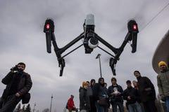 People watch the flight of Dji Inspire 1 drone UAV. Saint-Petersburg, Russia - 26 MARCH 2016; People watch the flight of Dji Inspire 1 drone UAV quadcopter which stock image
