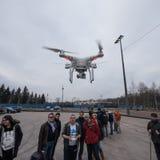 People watch the flight of Dji Inspire 1 drone UAV. Saint-Petersburg, Russia - 26 MARCH 2016; People watch the flight of Dji Inspire 1 drone UAV quadcopter which royalty free stock image