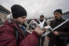 People watch the flight of Dji Inspire 1 drone UAV. Saint-Petersburg, Russia - 26 MARCH 2016; People watch the flight of Dji Inspire 1 drone UAV quadcopter which royalty free stock images