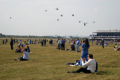 People watch the helicoprers flying Royalty Free Stock Photos