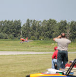 People watch Model Airplane Land Royalty Free Stock Photography