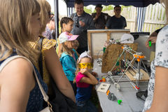 People watch the process of working 3D printer and laser on the Royalty Free Stock Image
