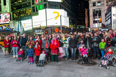 People watch the public TV show on a screen at Times Square by n. NEW YORK, USA - OCT 25, 2015: people watch the public TV show on a screen at Times Square by Stock Images
