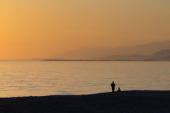 People watch the sunset. By the sea Stock Image
