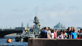 People watch to warships, St Petersburg, Russia. People watch from the embankment to warships, St Petersburg, Russia stock footage