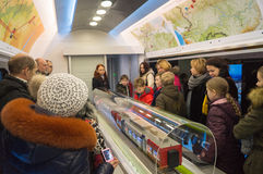 People watch train layouts in a railway carriage Stock Images