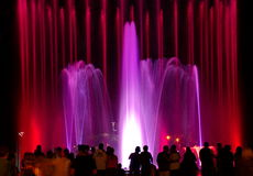 Free People Watching Beautiful Light-colored Fountains Stock Images - 57164754