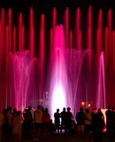 People watching beautiful light-colored fountains Stock Photo