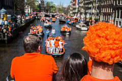 People watching the boats - Koninginnedag 2012 royalty free stock images
